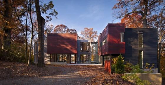 casa em vidro madeira e concreto